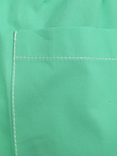 Брюки из хлопка со складками у пояса - Деталь