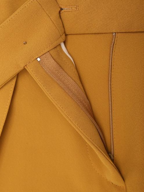 Укороченные брюки с карманами  - Деталь