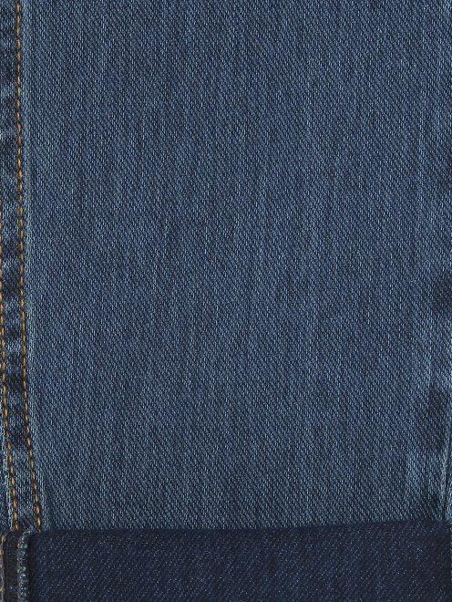 Зауженные джинсы из эластичного денима - Деталь2